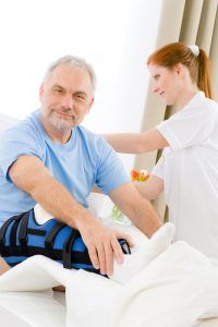 nurse taking car of man with orthopedic injury undergoing stem cell therapy on the knee